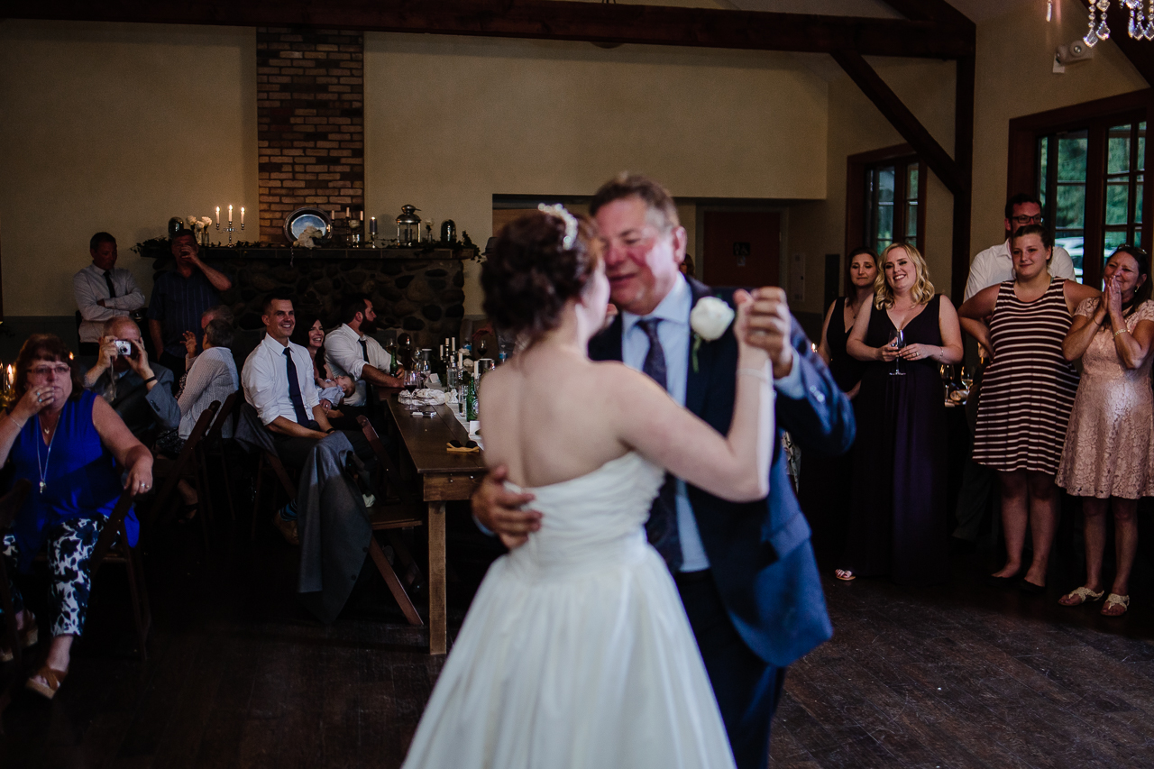 father daughter dance guest reaction during candle light rustic themed wedding reception at Kwomais Hall by Kwomais Point Park in Ocean Park Surrey british columbia by best wedding photographer from Langley Mimsical Photography Christina Voorhorst style is documentary candid and fun photos