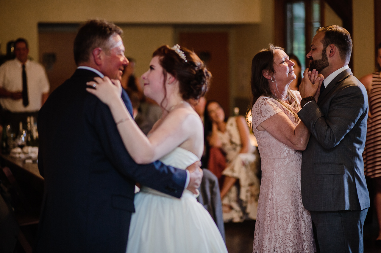 father daughter and mother daughter dances during candle light rustic themed wedding reception at Kwomais Hall by Kwomais Point Park in Ocean Park Surrey british columbia by best wedding photographer from Langley Mimsical Photography Christina Voorhorst style is documentary candid and fun photos