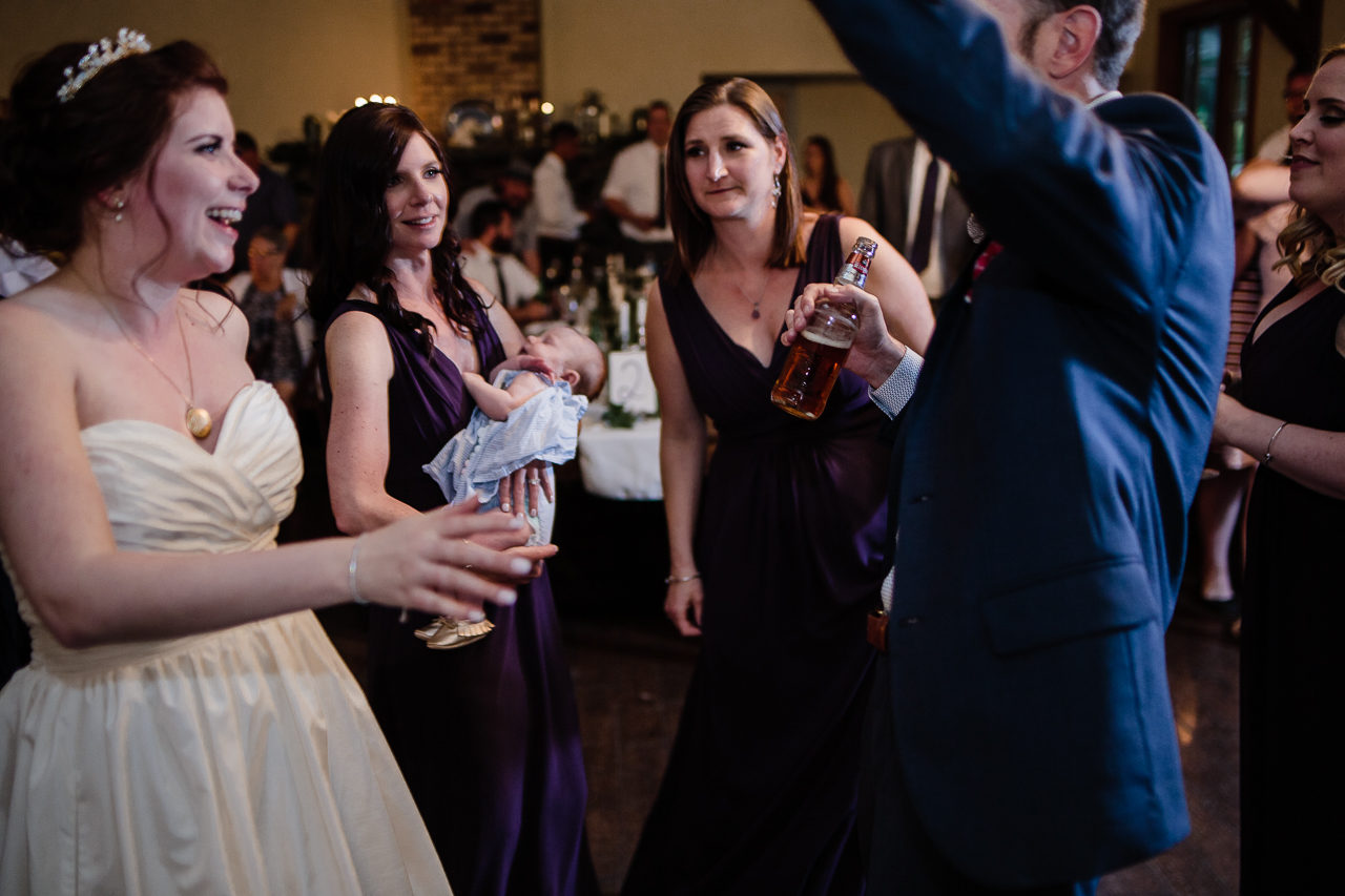 dance floor during candle light rustic themed wedding reception at Kwomais Hall by Kwomais Point Park in Ocean Park Surrey british columbia by best wedding photographer from Langley Mimsical Photography Christina Voorhorst style is documentary candid and fun photos