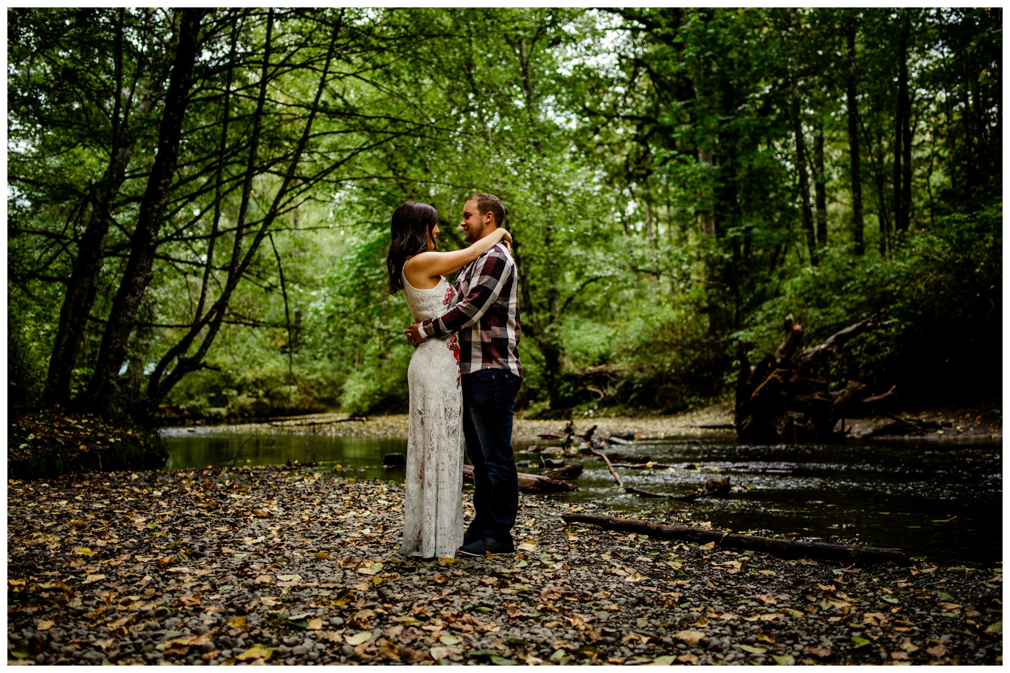 Williams Park Aldergrove Engagement Photographer Moody Fall Couple River Water Romantic Pose Yellow Leaves White Dress Dark_0001.jpg