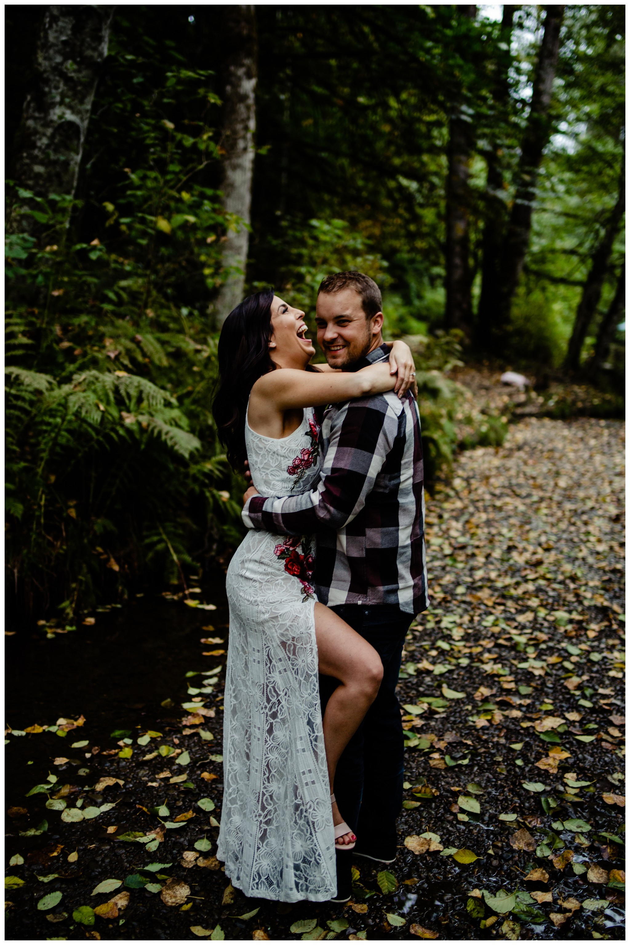 Williams Park Aldergrove Engagement Photographer Moody Fall Couple River Water Romantic Pose Yellow Leaves White Dress Dark_0011.jpg