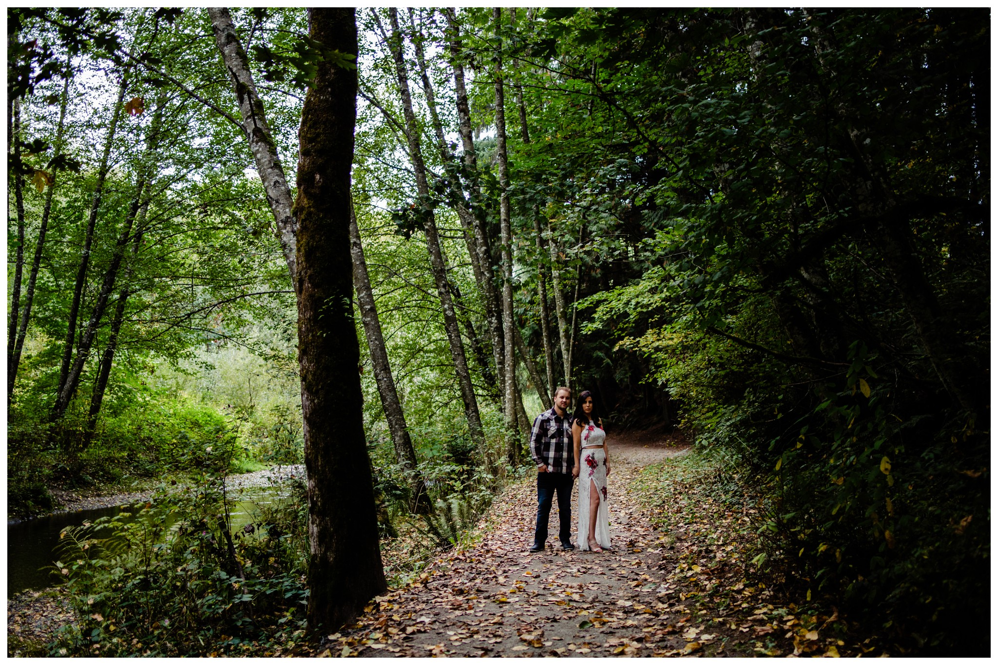 Williams Park Aldergrove Engagement Photographer Moody Fall Couple River Water Romantic Pose Yellow Leaves White Dress Dark_0013.jpg