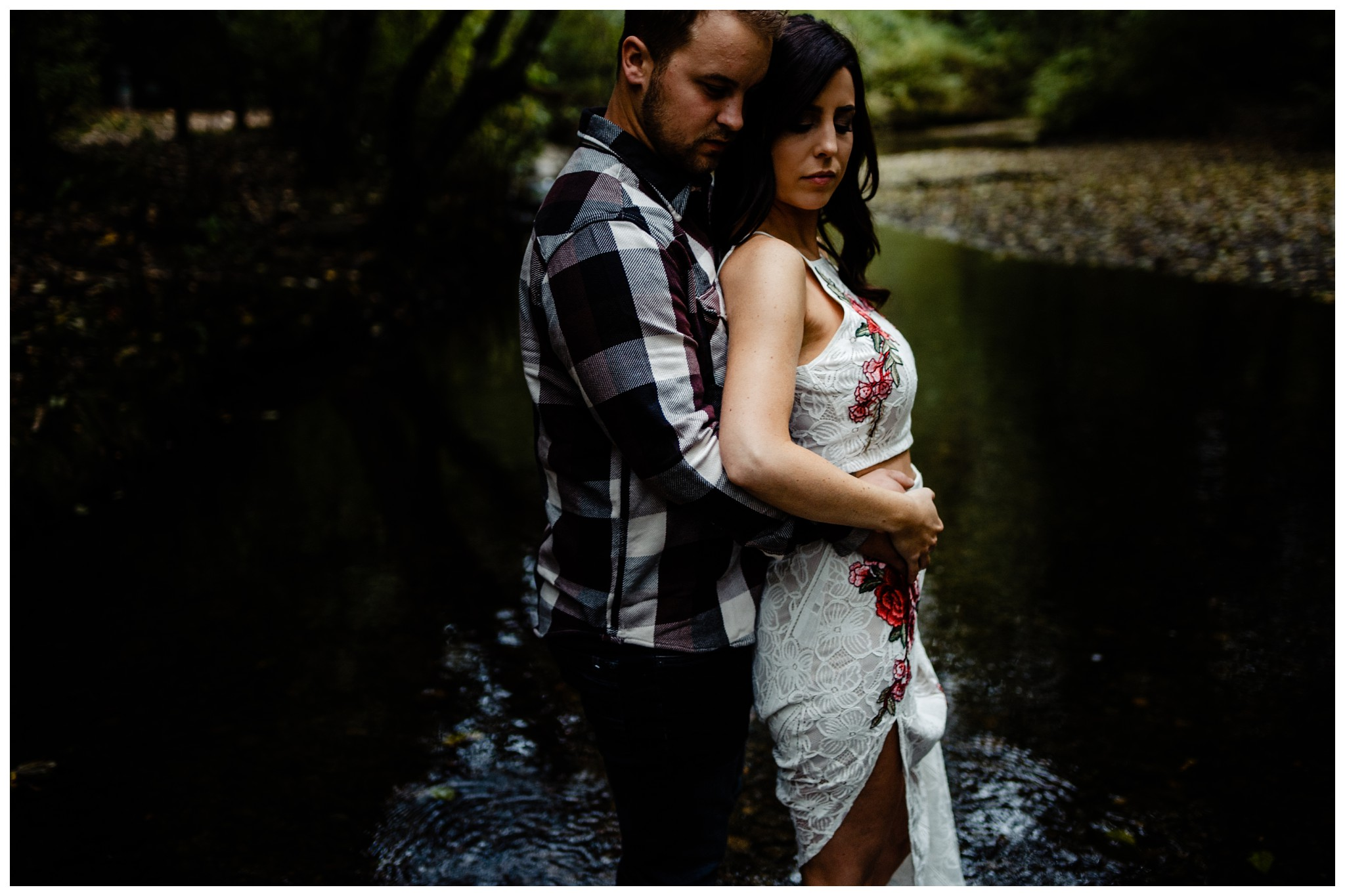 Williams Park Aldergrove Engagement Photographer Moody Fall Couple River Water Romantic Pose Yellow Leaves White Dress Dark_0018.jpg