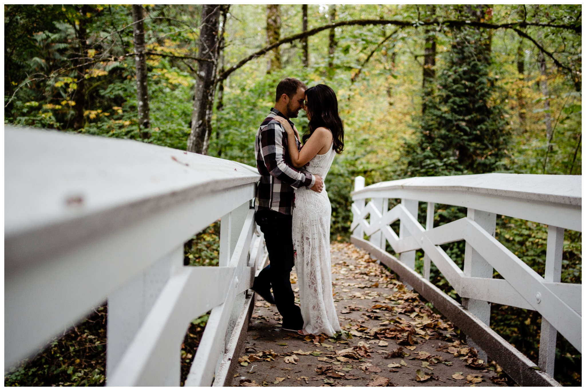 Williams Park Aldergrove Engagement Photographer Moody Fall Couple River Water Romantic Pose Yellow Leaves White Dress Dark_0020.jpg