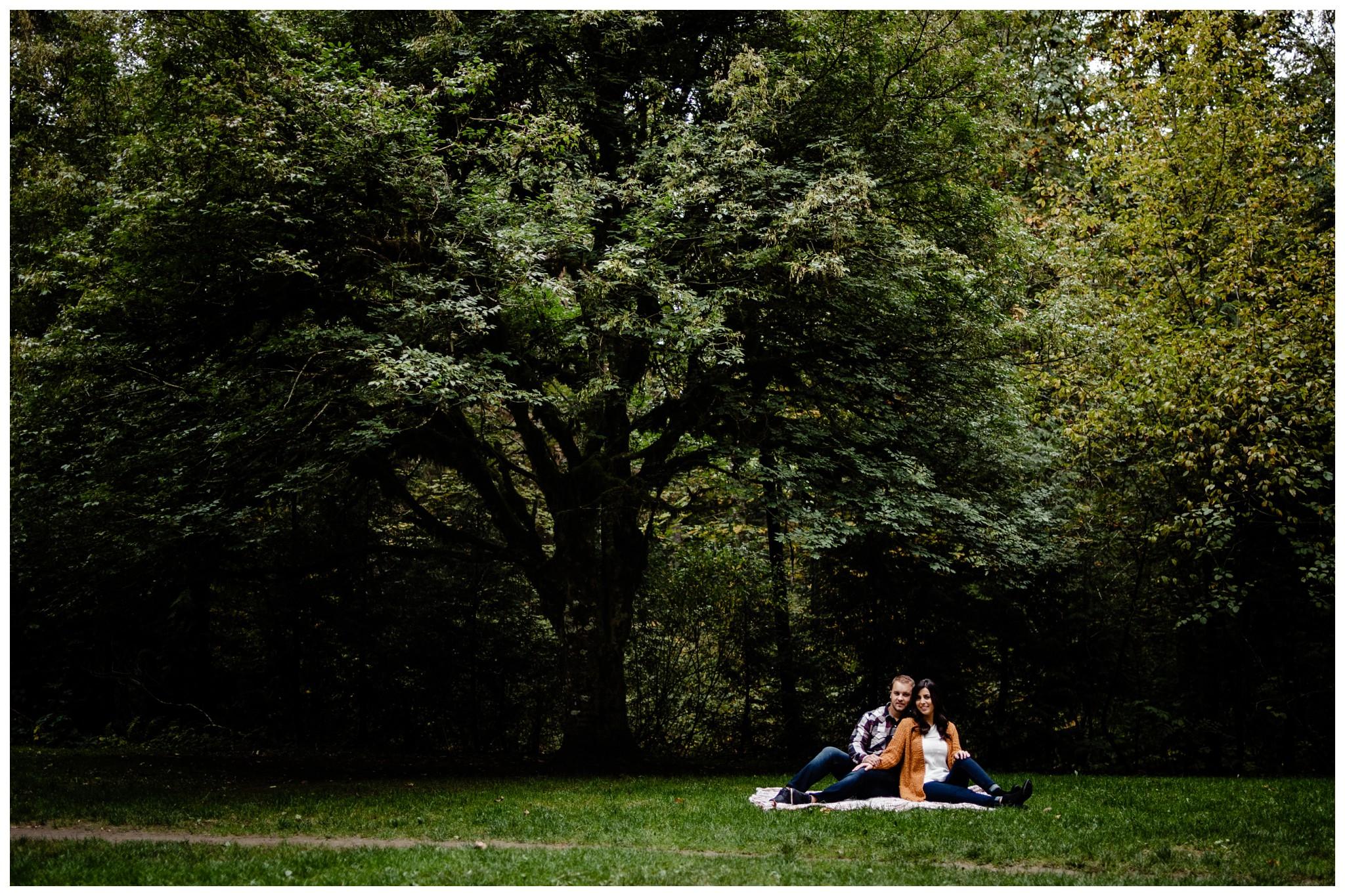 Williams Park Aldergrove Engagement Photographer Moody Fall Couple River Water Romantic Pose Yellow Leaves White Dress Dark_0031.jpg