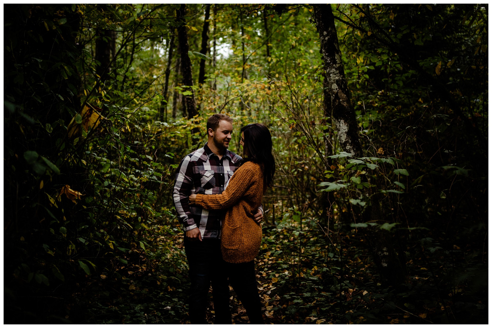Williams Park Aldergrove Engagement Photographer Moody Fall Couple River Water Romantic Pose Yellow Leaves White Dress Dark_0033.jpg