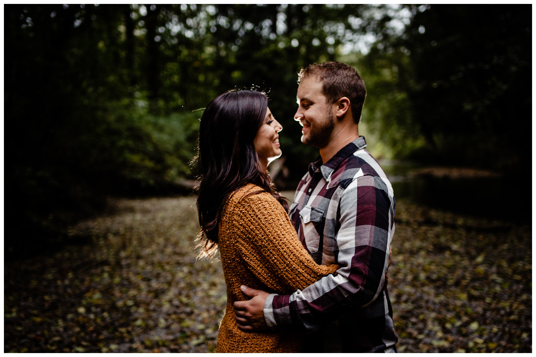 Williams Park Aldergrove Engagement Photographer Moody Fall Couple River Water Romantic Pose Yellow Leaves White Dress Dark_0035.jpg
