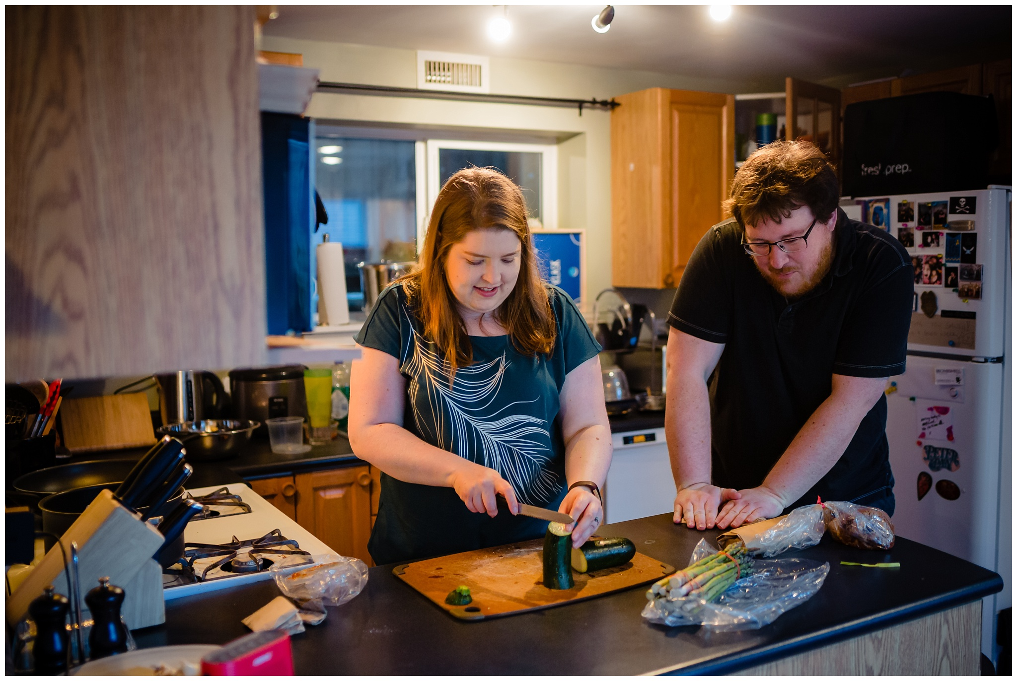 Granville Island Public Market Candid Documentary Engagement Photos Making Dinner In home Romantic BBQ fun plus size couple_0014.jpg