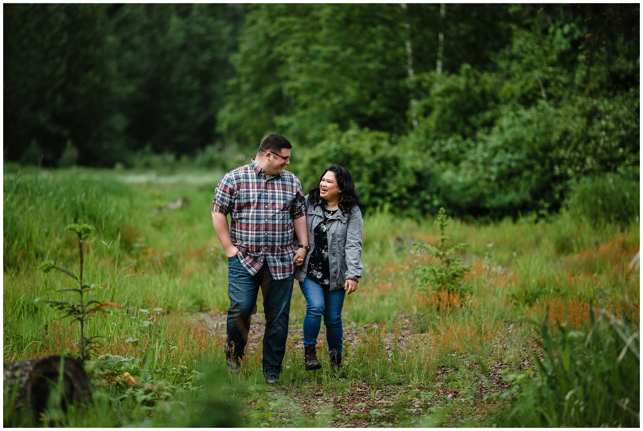 McKay Creek Park Abbotsford Spring Engagement Photos Happy Forest Trees Green Candid Fun Couple Photos_0009.jpg