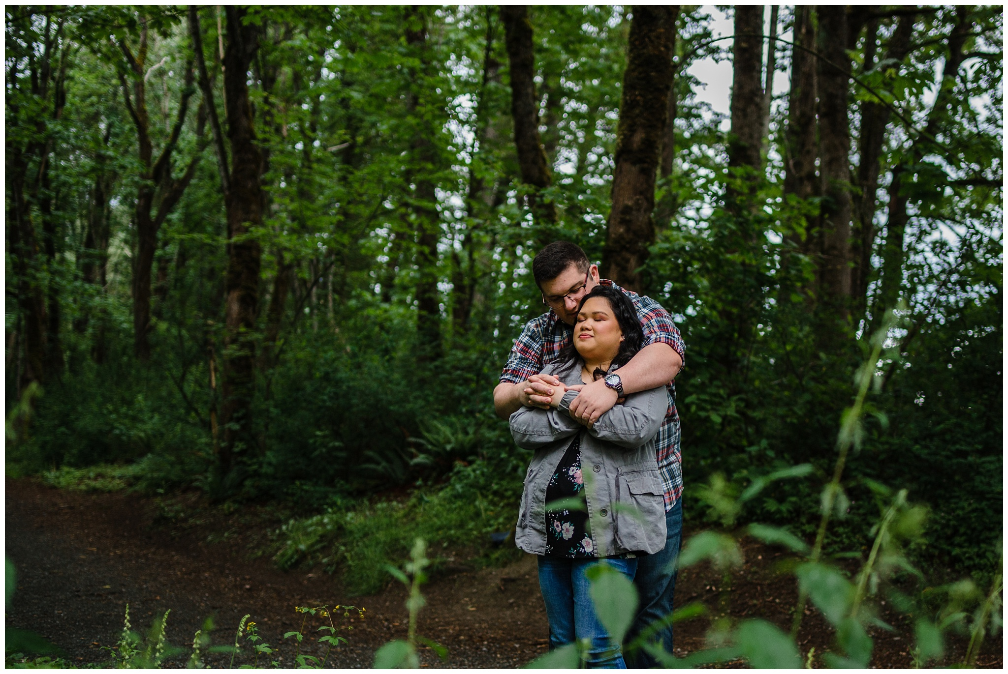 McKay Creek Park Abbotsford Spring Engagement Photos Happy Forest Trees Green Candid Fun Couple Photos_0015.jpg
