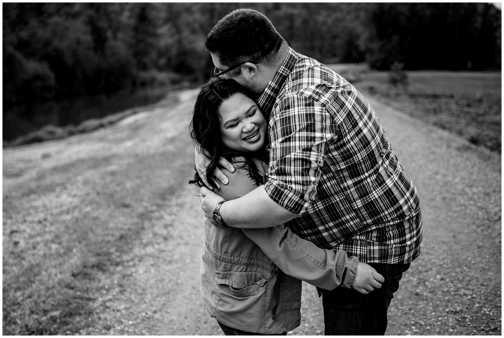 McKay Creek Park Abbotsford Spring Engagement Photos Happy Forest Trees Green Candid Fun Couple Photos_0024.jpg