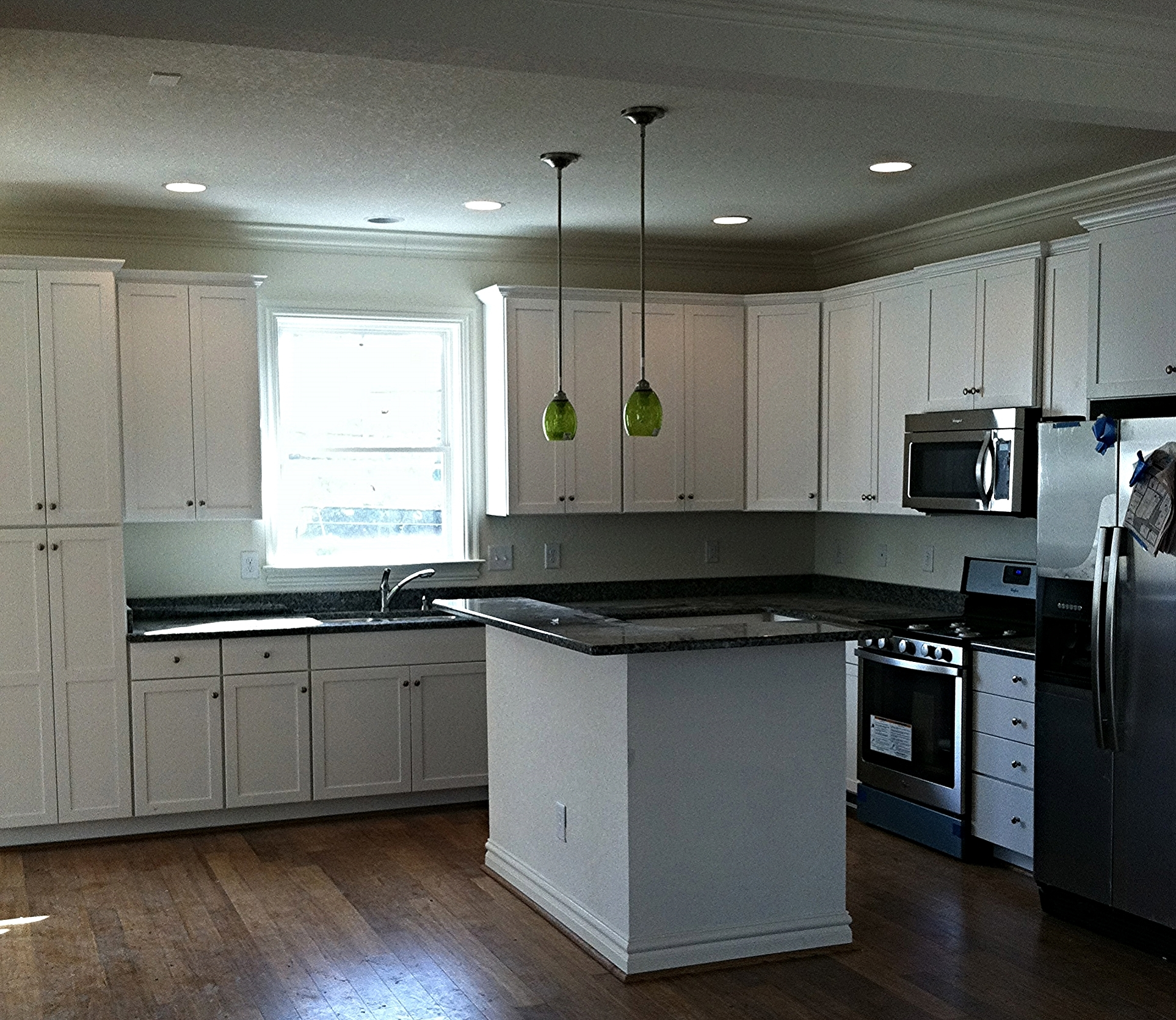 White Painted Shaker Style Cabinets.
