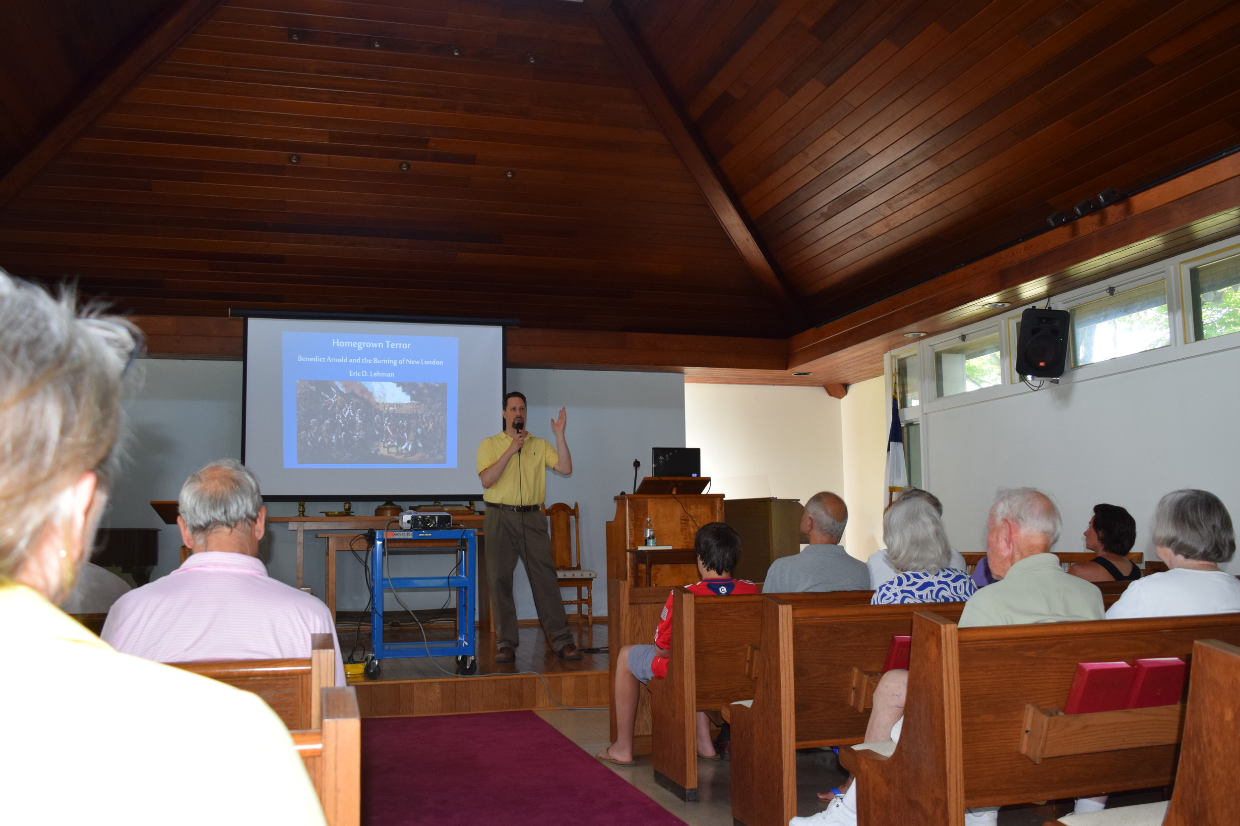 Eric giving a presentation at the church on Fisher's Island for the Henry Ferguson museum.