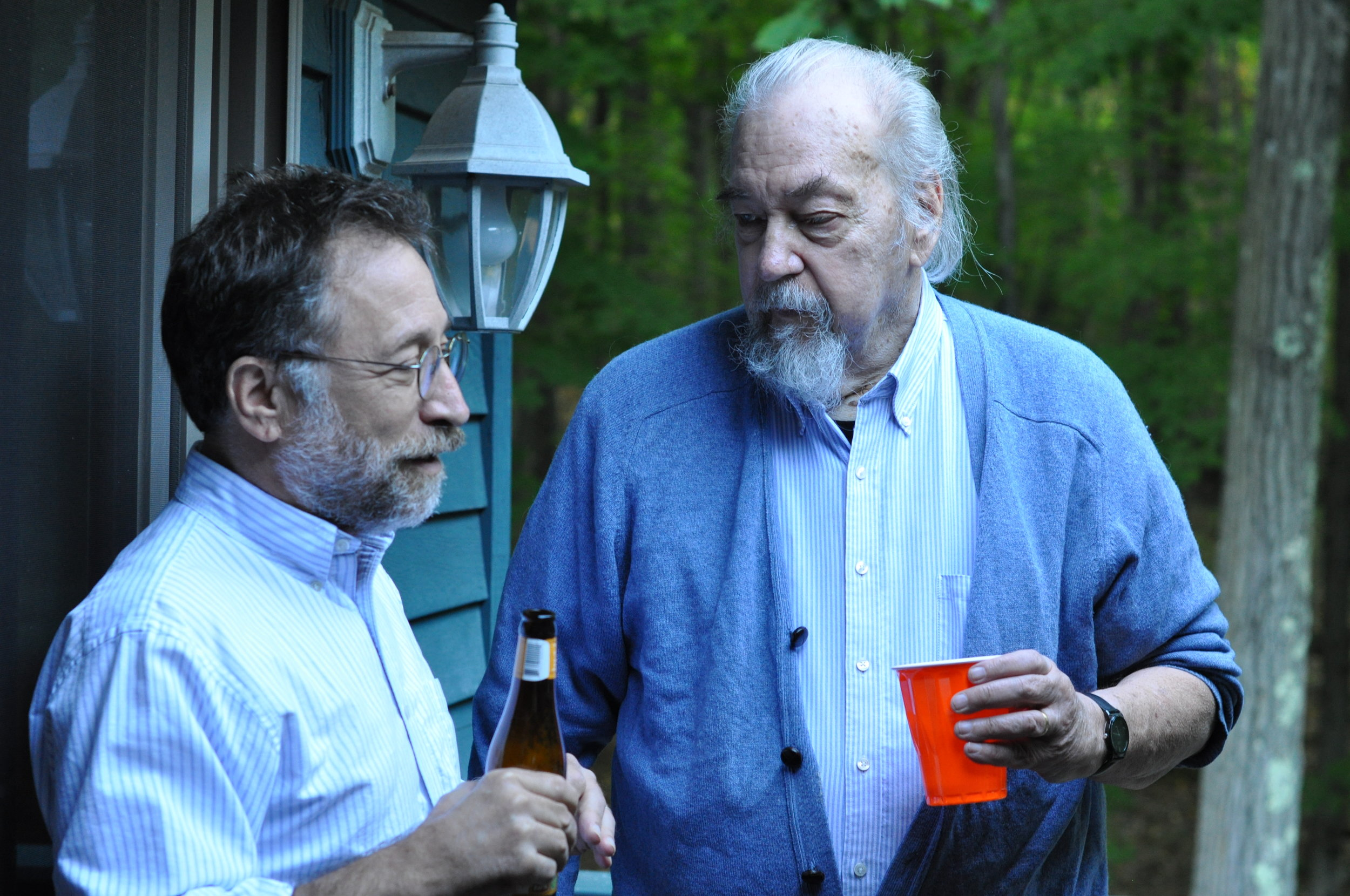 Dick Allen (right) chats with fellow Connecticut author David Leff at Nomad's End.