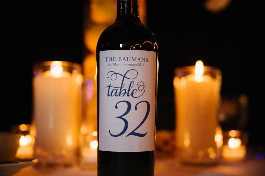 Custom printed wine bottle table numbers feature the wedding year 'vintage date'