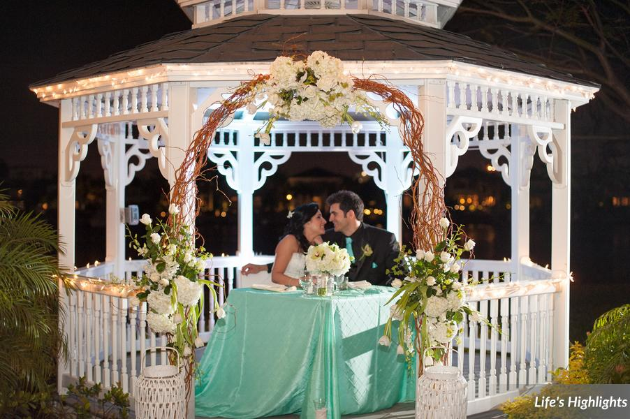 The bride and groom enjoyed a few intimate moments at their sweetheart table inside the decorated gazebo