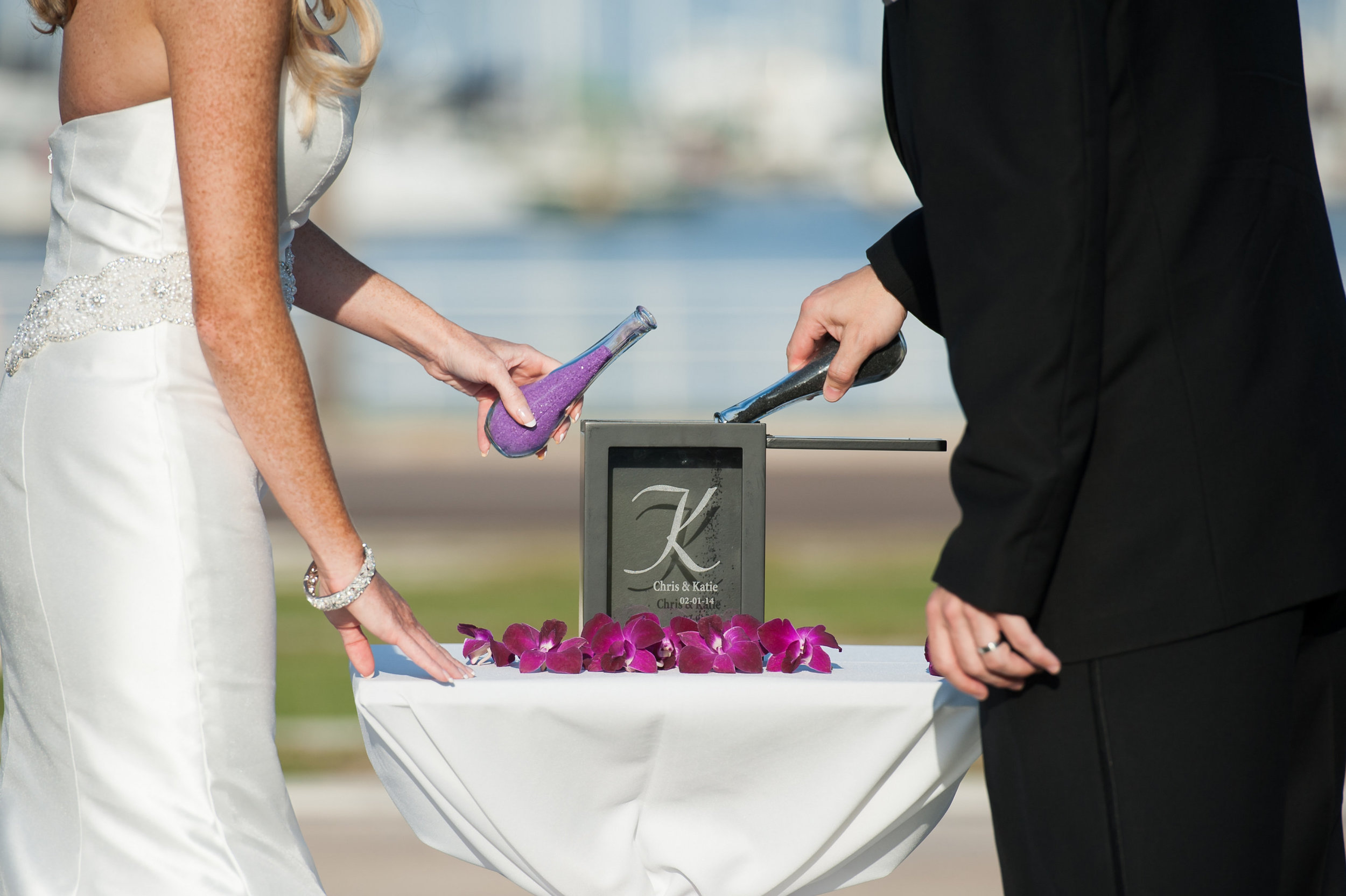 A unique sand ceremony frame customized with the couple's names made for a chic keepsake