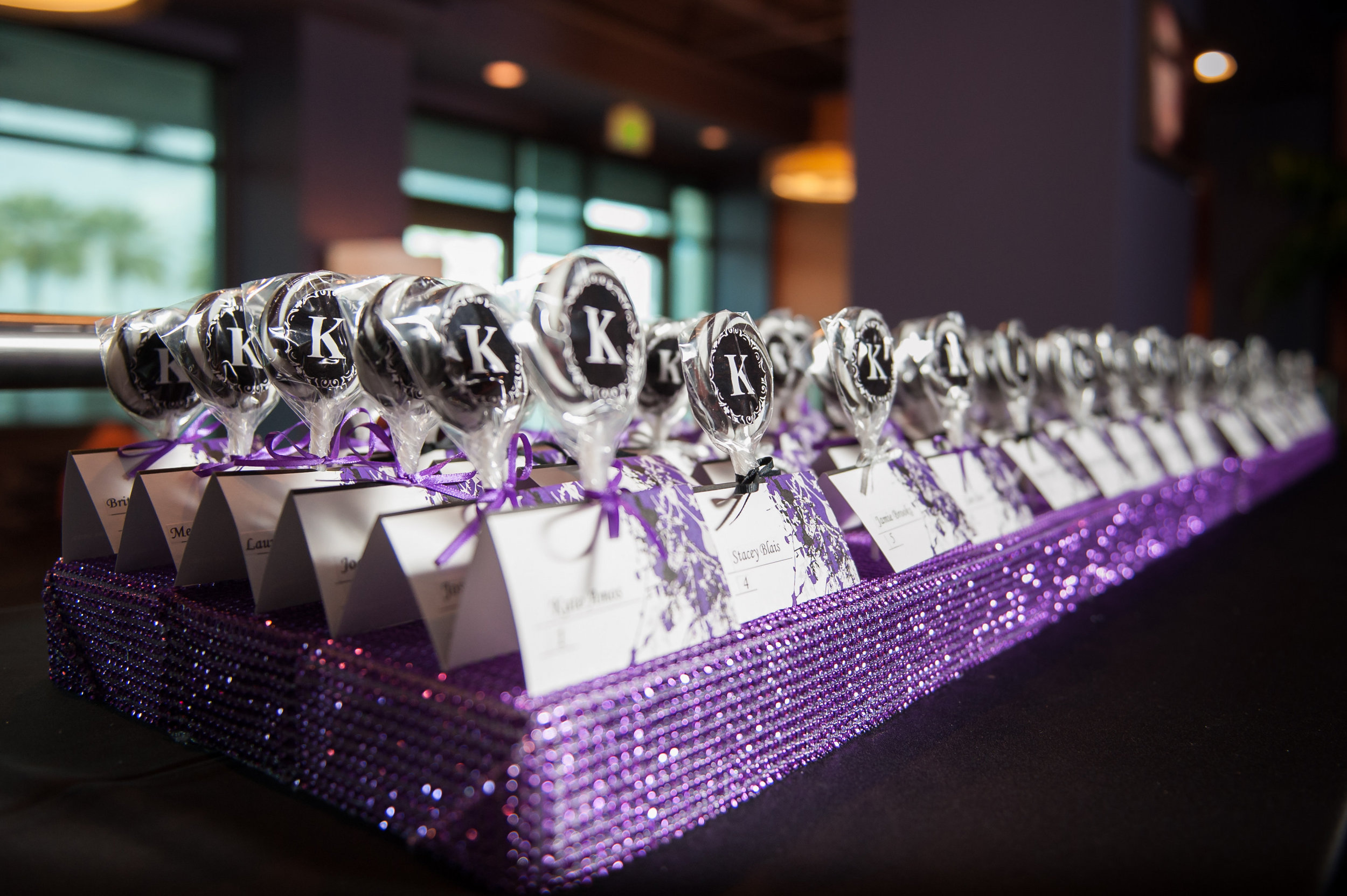 Rows of swirled lollipop escort cards gave guests a glimpse into the sweet night in store...