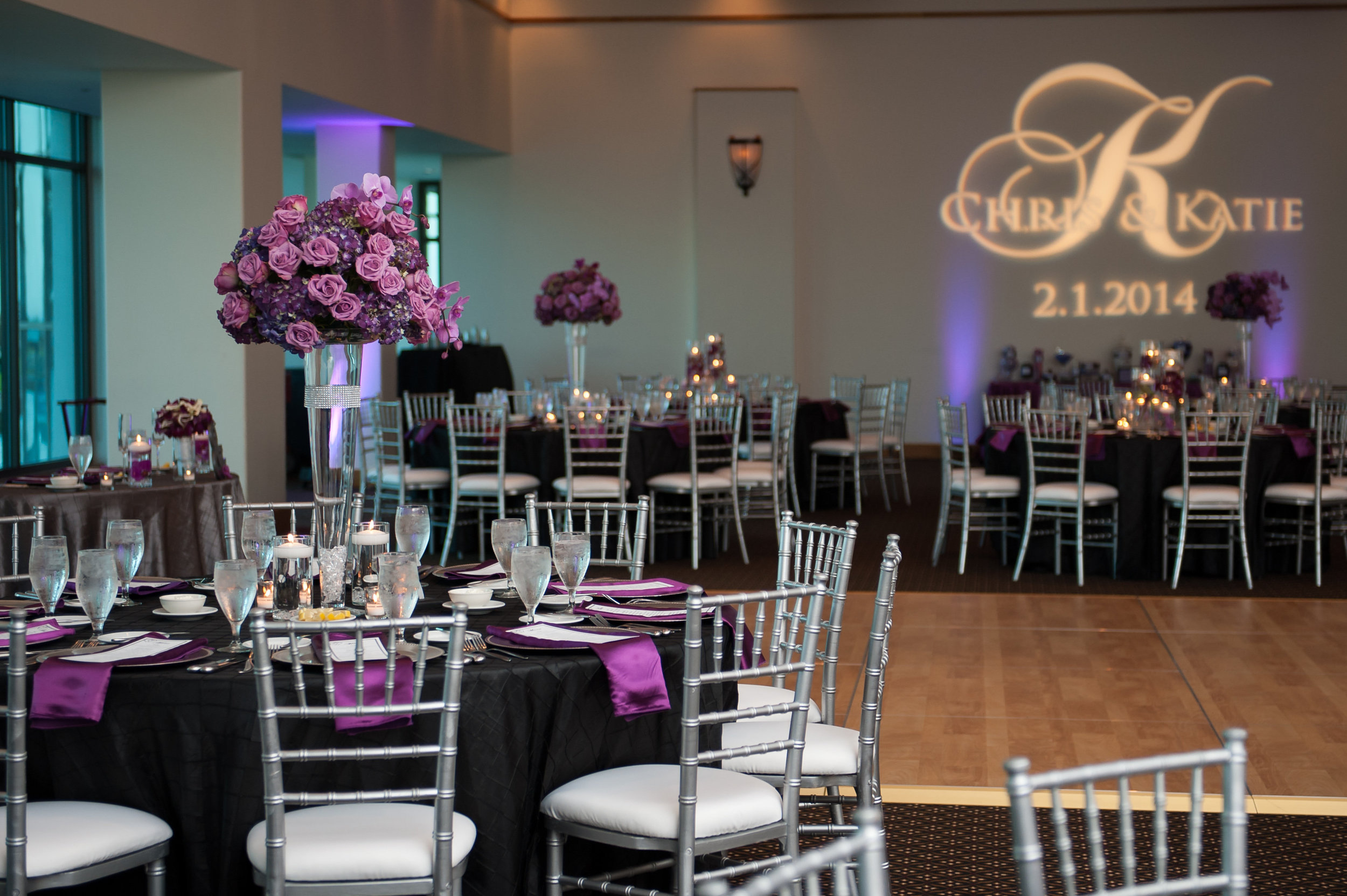 The ballroom featured tables dressed in onyx linens with silver accents, and pops of plum.