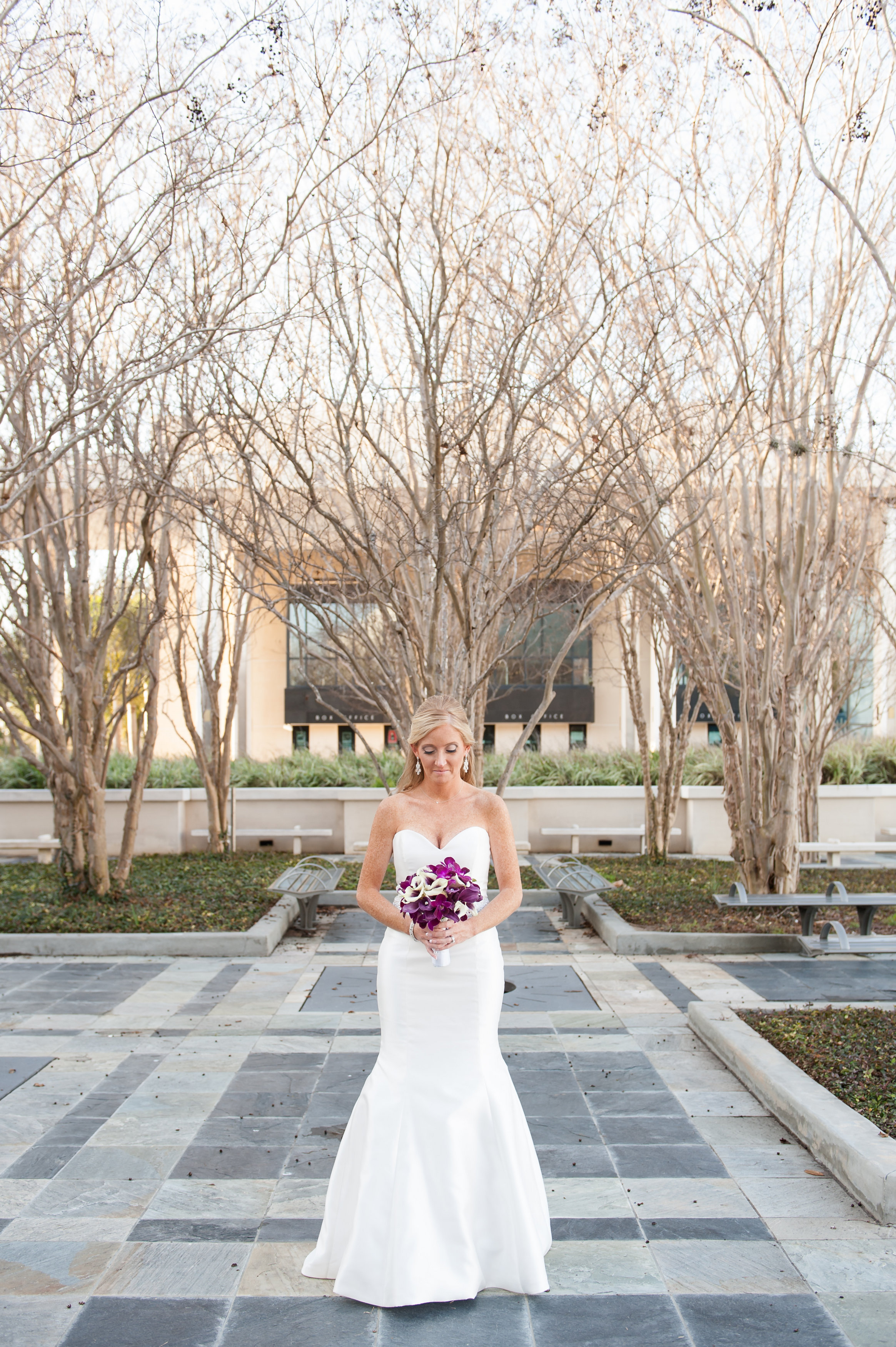 The bride wore a fit and flare gown and carried a bouquet of Picasso calla lilies and orchids