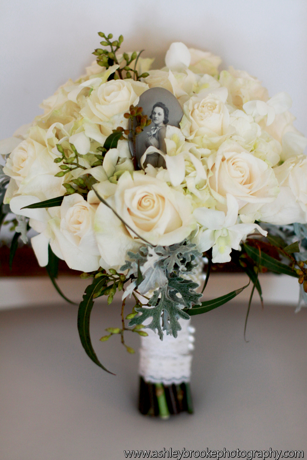 Jackie carried a bouquet of white hydrangea, roses, seeded eucalyptus, and dusty miller.