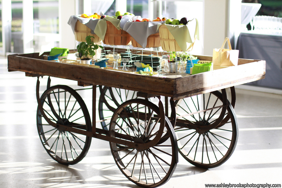 A vintage cart boasted fresh fruits and vegetables with assorted dips and cheeses