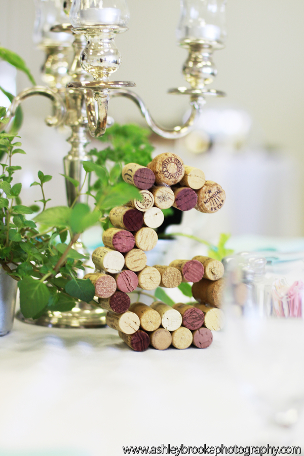 Wine cork table numbers accented tables adorned with silver candelabras and potted herbs