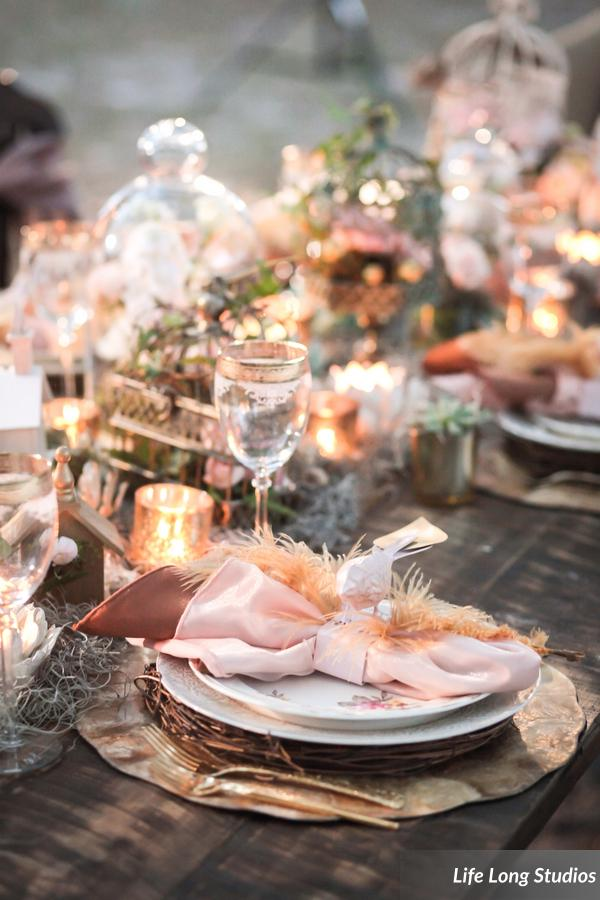 The table featured layered place settings, an abundance of candlelight, and whimsical bird accents.