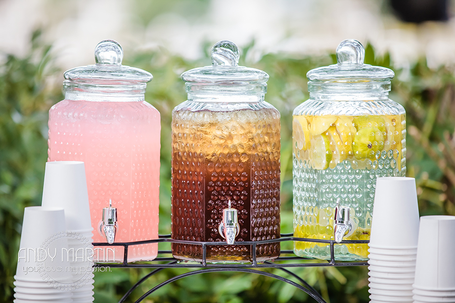 Beverage dispensers of infused water, tea, and lemonade artfully displayed for early arriving guests