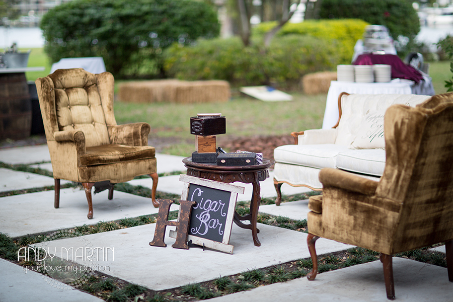 Vintage furniture set on paver stones created an inviting cigar lounge