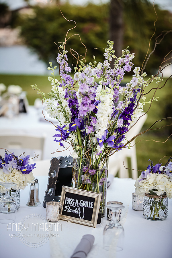 Centerpieces included tall vases of curly willow and colorful stock, as well as silver lanterns surrounded by flora