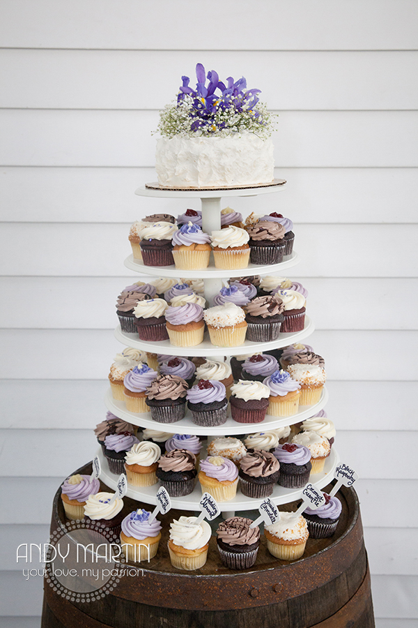 A tower of cupcakes set atop a vintage wine barrel offered flavors like Honey Lavender and Coconut Cream Pie
