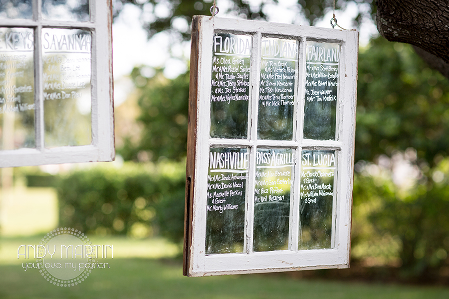 The seating assignments were written on vintage window panes suspended in the sprawling Oak trees