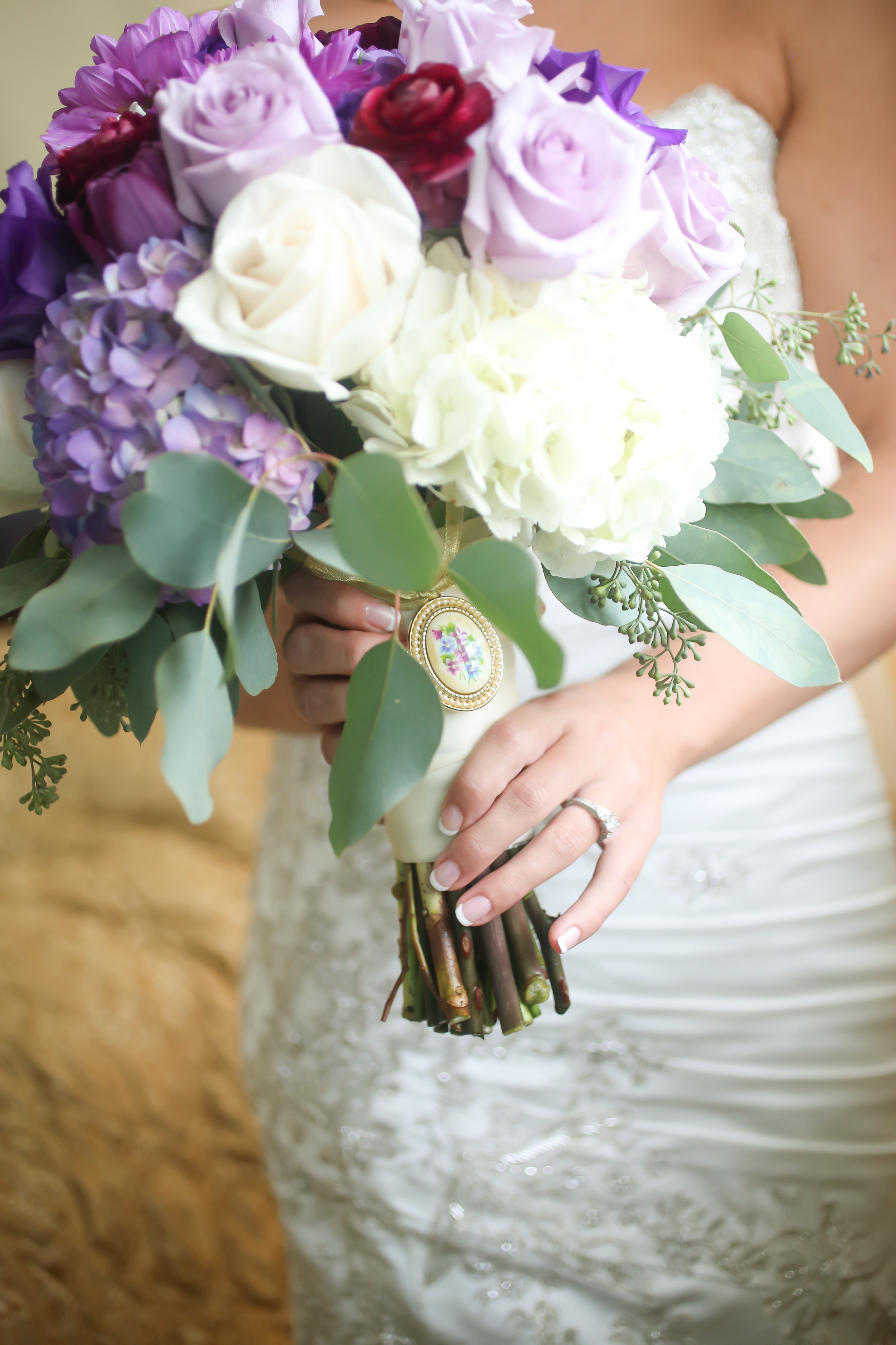 The bride's bouquet contained hydrangea, roses, chrysanthemums, tulips, ranunculus, and eucalyptus