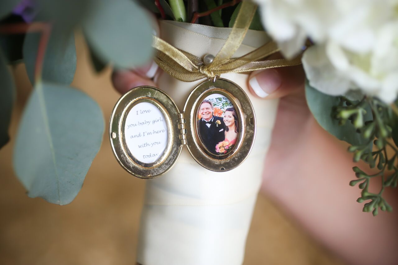 As a surprise for the bride, the bouquet was accented with a locket containing a photo of her late father