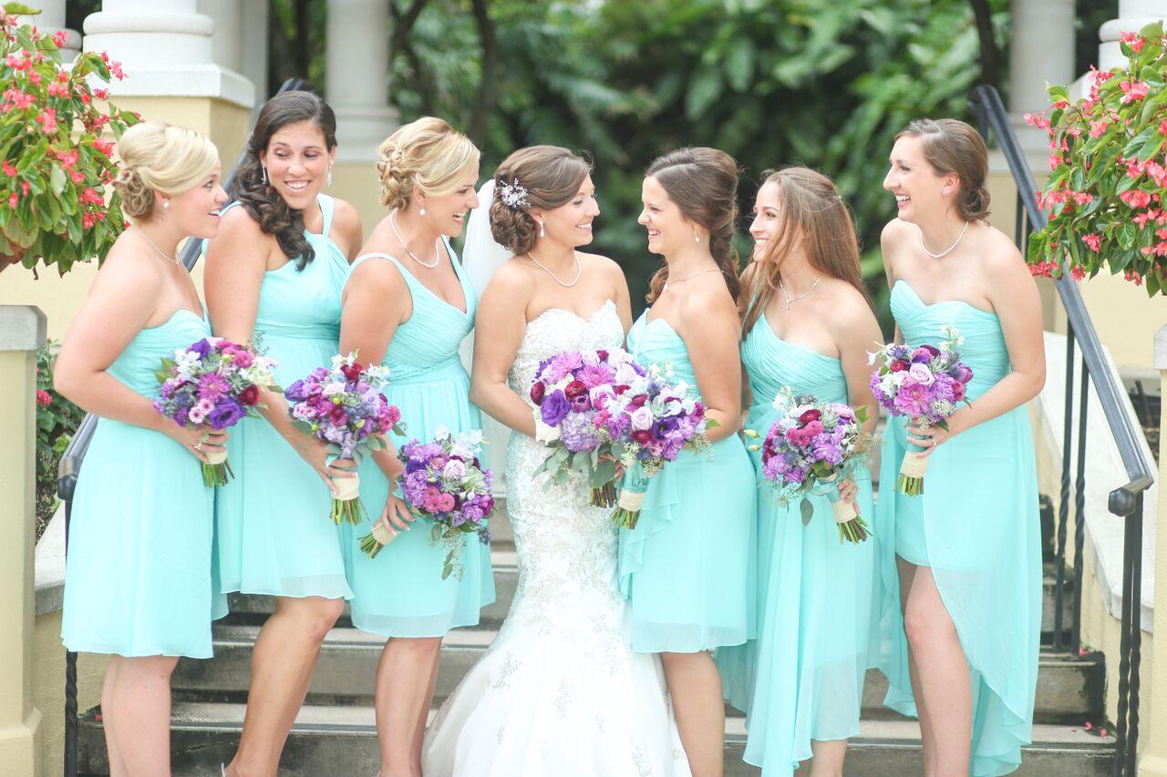 Bridesmaids wore mismatched aqua chiffon dresses