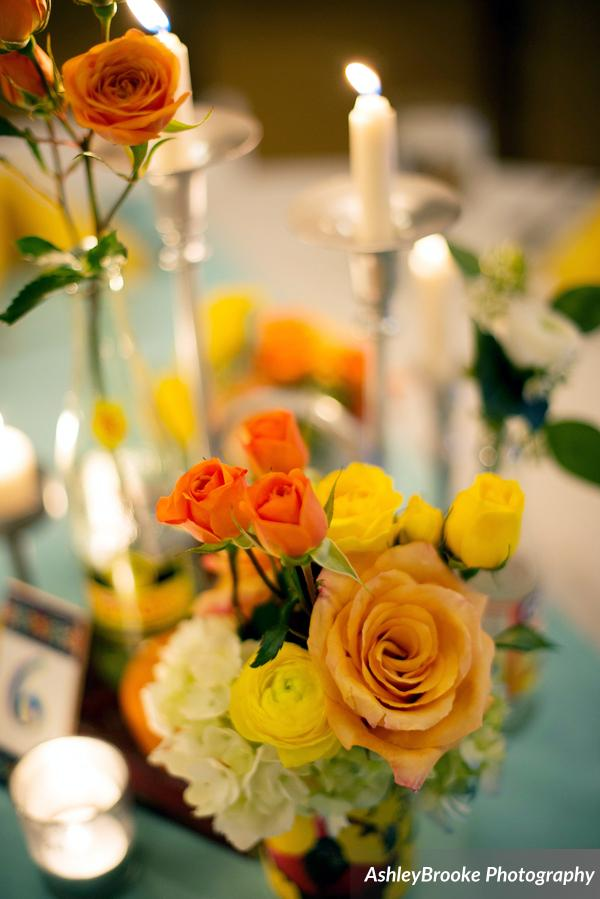 Centerpieces featured cigar boxes accented with cans and bottles of flowers, candlesticks, and Florida citrus