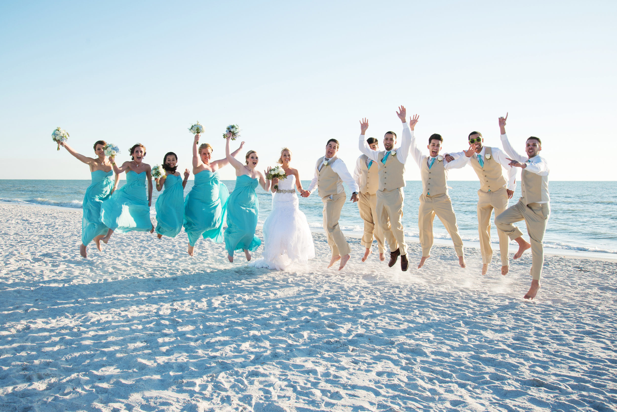 The wedding party sported shades of turquoise and khaki, perfect for a beach wedding