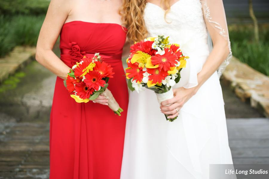 Bouquets of brightly colored daisies and calla lilies were wrapped in burlap and satin