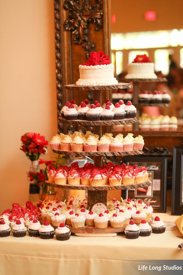 The cupcakes were displayed on a handmade tower of cut tree limbs