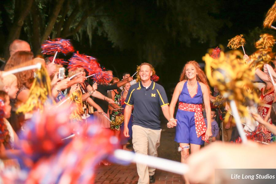 The bride and groom changed into collegiate colors and were sent off through team pom poms