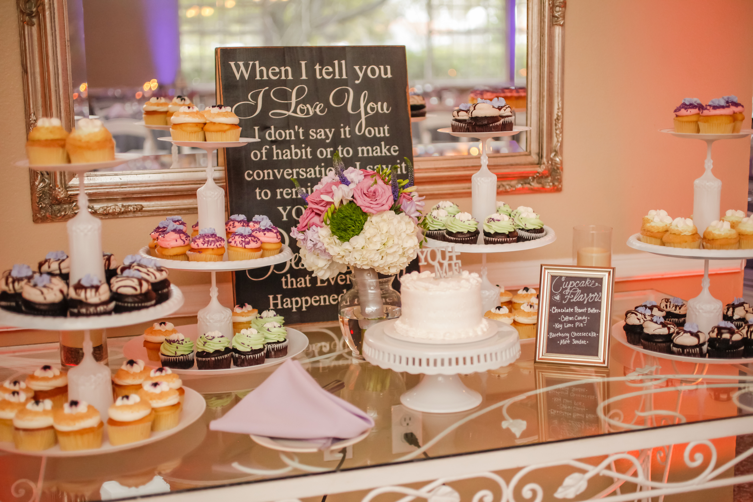 The couple ceremoniously cut a small cake and served assorted cupcakes for dessert.