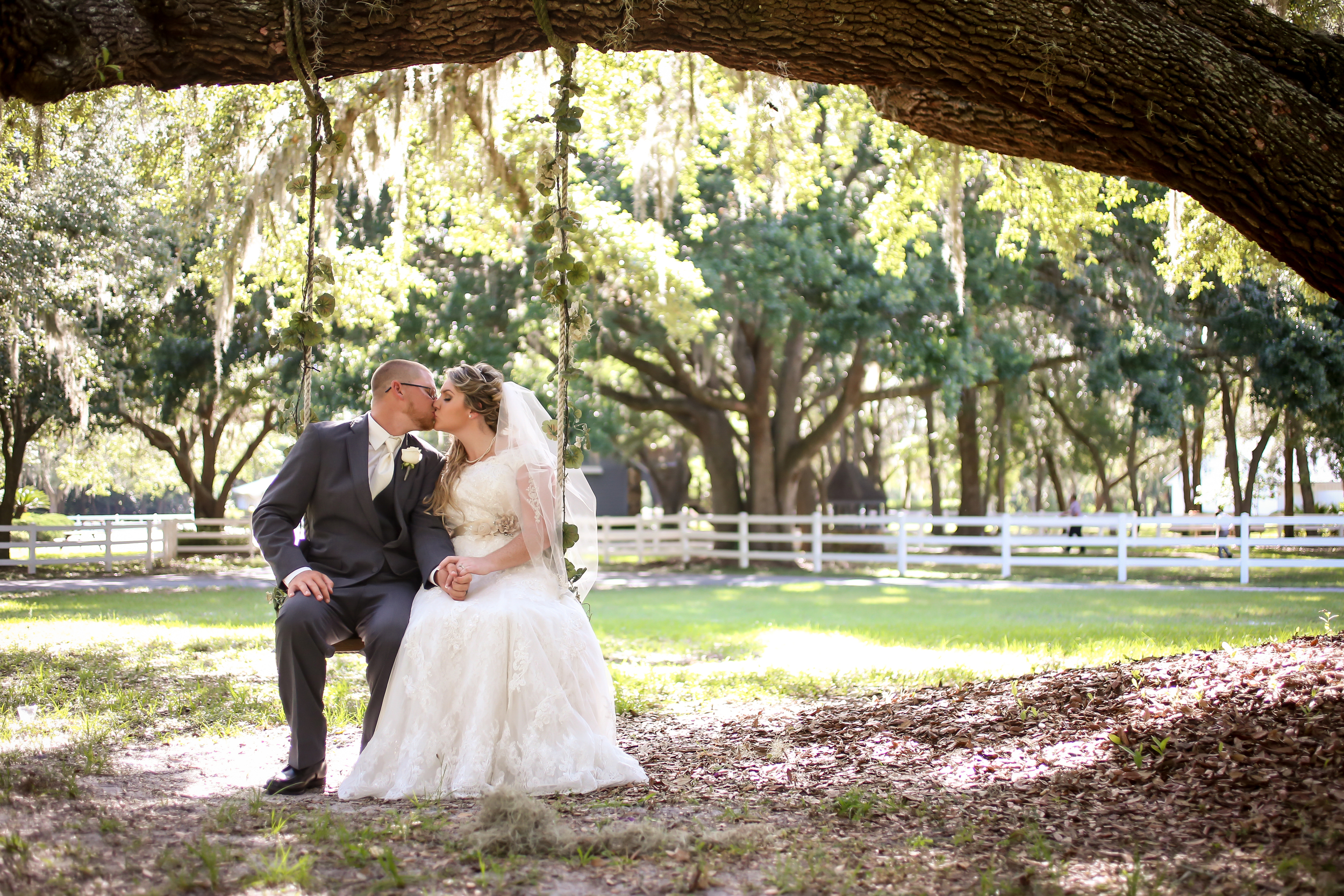 The couple shared a sweet moment alone on a shady tree swing beneath a towering Oak