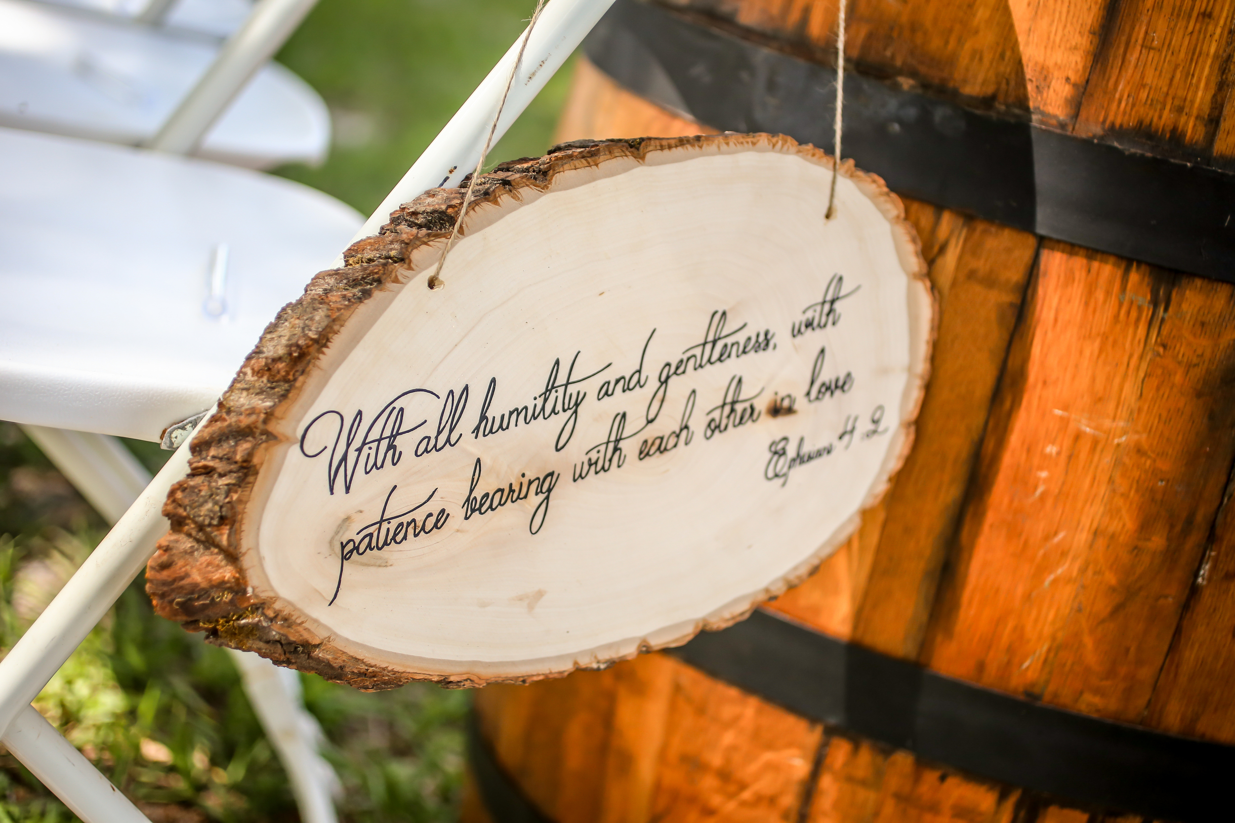 The aisle was lined with cut wood slabs with handwritten Bible verses