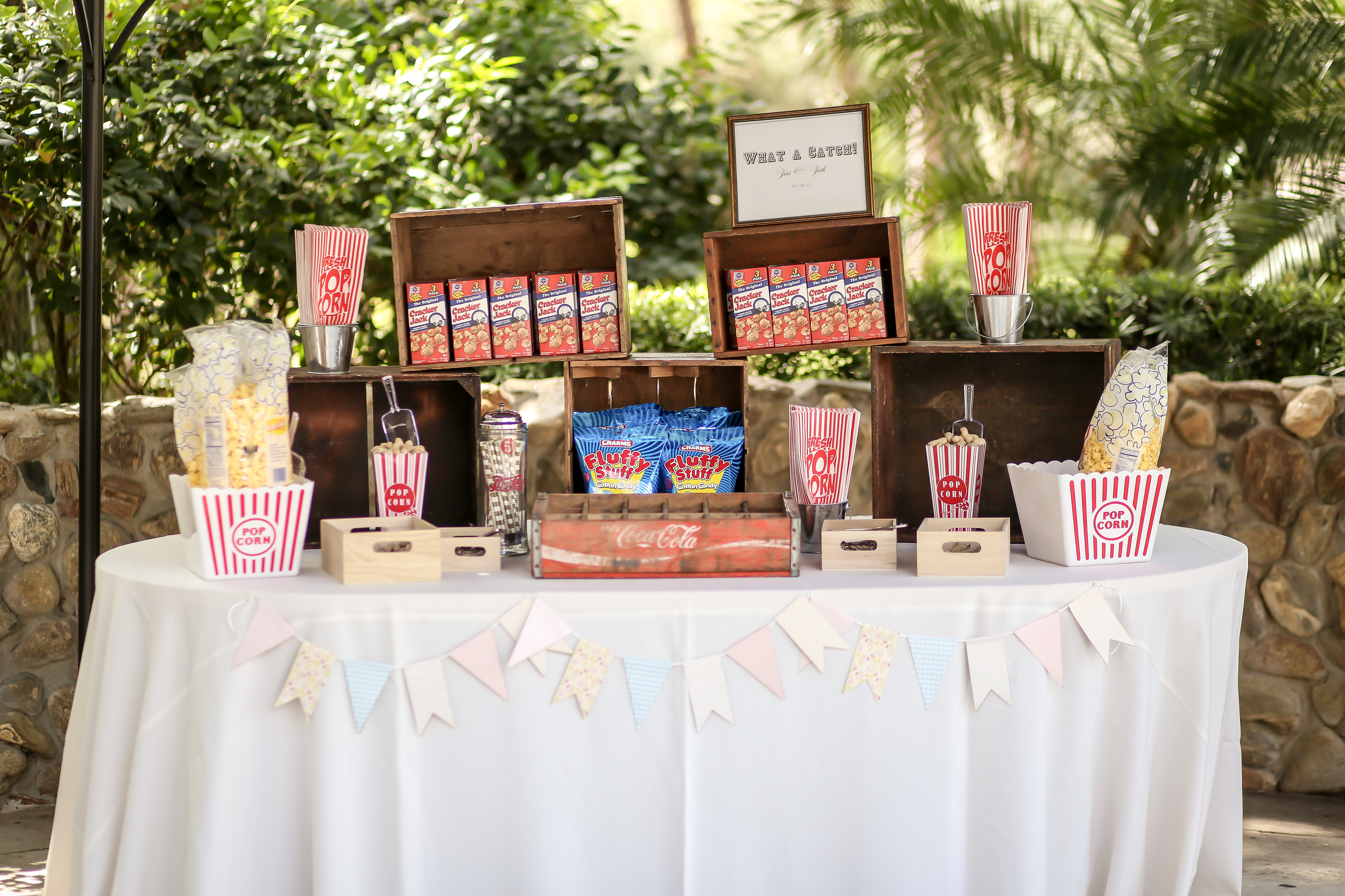 As a nod to the couple's first date, a vintage-style concession stand offered baseball snack favorites