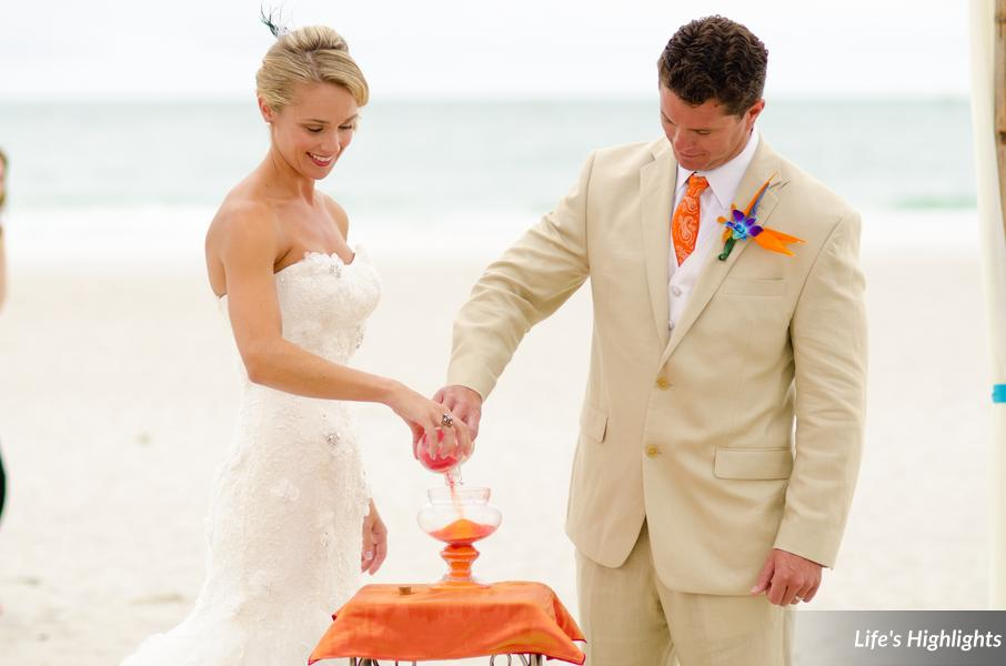 The couple participated in a unity sand ceremony, mixing two colors of sand to symbolize their marriage