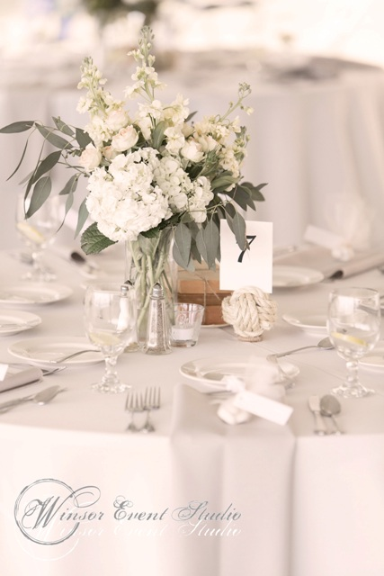 Rope table numbers accented the loose and natural centerpieces