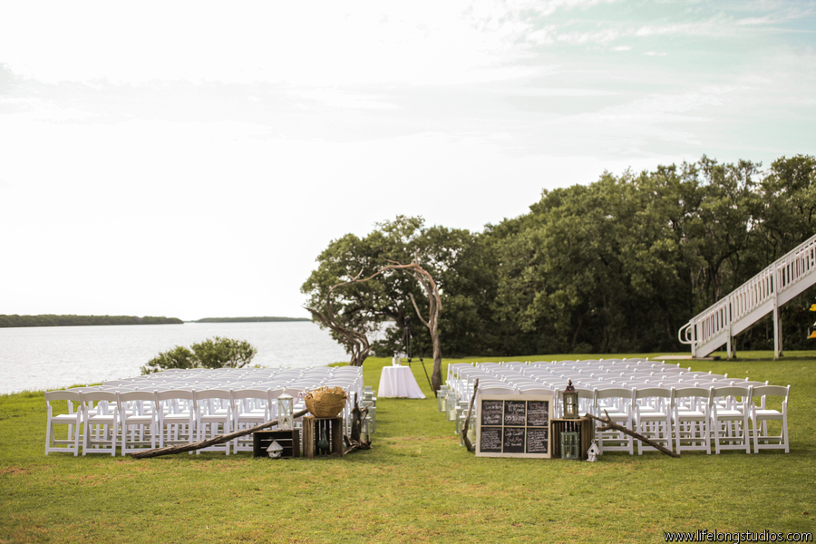 Crates, lanterns, and driftwood accented the ceremony aisle along with a decorative chalkboard program