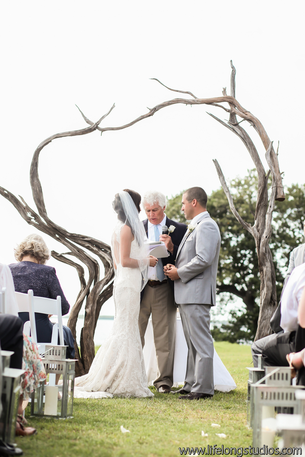 A driftwood arch made for a stunning focal point at the waterfront ceremony