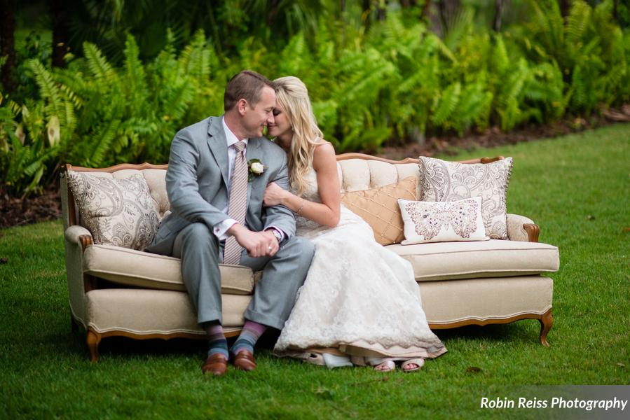 The couple were married at a private estate, surrounded by lush landscaping and lakefront views